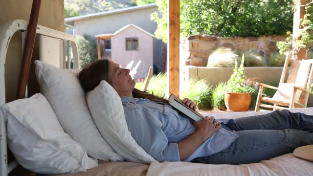 baby boomer woman on outdoor bed - front stoop stock videos & royalty-free footage