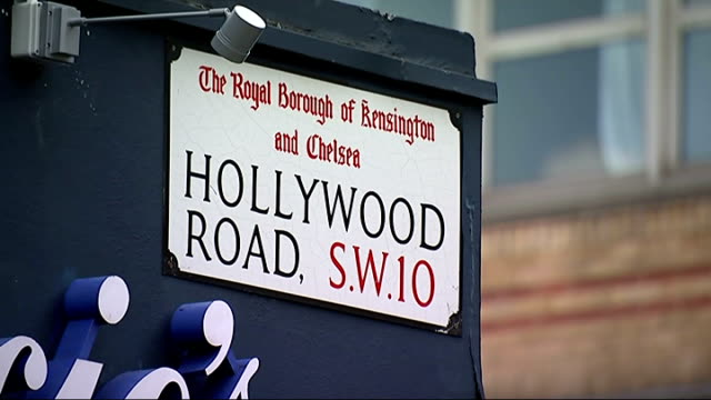 "baby born on pavement in chelsea; reporter and vivian in street street sign ""hollywood road sw10"" vivian gray sot - i think it's going to be very... - ヒトの口点の映像素材/bロール"