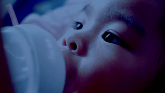 baby bottle feeding - milk bottle stock videos & royalty-free footage
