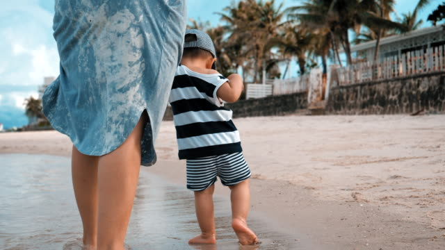 baby boy and his mother walking on the beach - 6 11 months stock videos & royalty-free footage