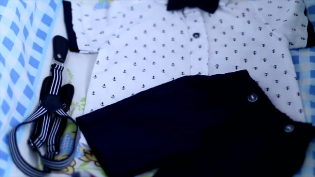 baby boy clothes - folded stock videos & royalty-free footage