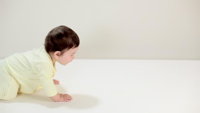 baby boy crawling past camera - crawling stock videos & royalty-free footage