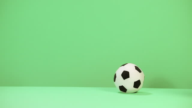 baby boy crawling past football - ein männliches baby allein stock-videos und b-roll-filmmaterial