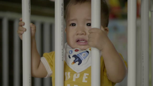 baby boy crying in crib at home - crib stock videos & royalty-free footage