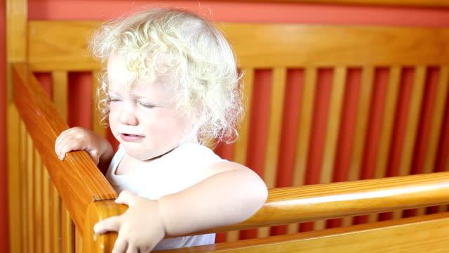Baby boy crying in crib