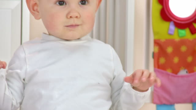 hd: baby boy curiously looking somewhere - one baby boy only stock videos & royalty-free footage