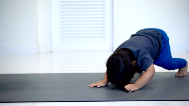 baby boy doing funny yoga downward-facing dog at home. - preschool child stock videos & royalty-free footage