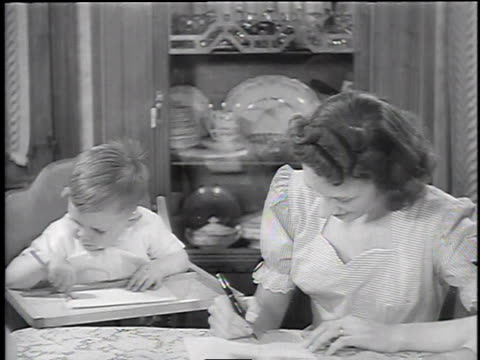 1945 montage baby boy doodling with a pencil / united states - scribble stock videos & royalty-free footage