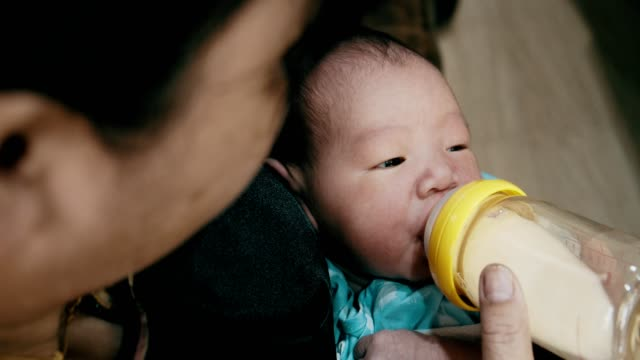 baby boy(0-1 months) drinking from a bottle milk - wishing well stock videos & royalty-free footage