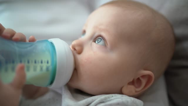 baby boy drinking milk from milk bottle - milk stock videos & royalty-free footage