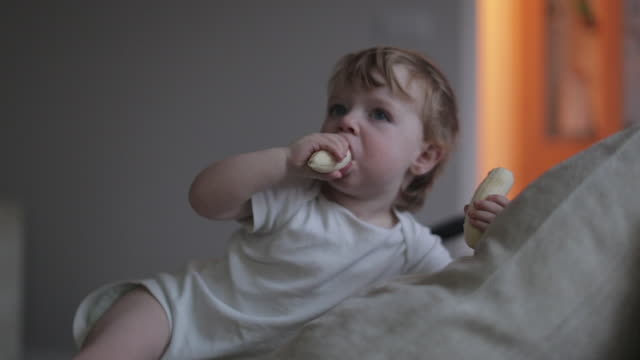 baby boy eating a banana - one baby boy only stock videos & royalty-free footage