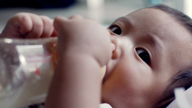 baby boy eating close up - milk bottle stock videos & royalty-free footage