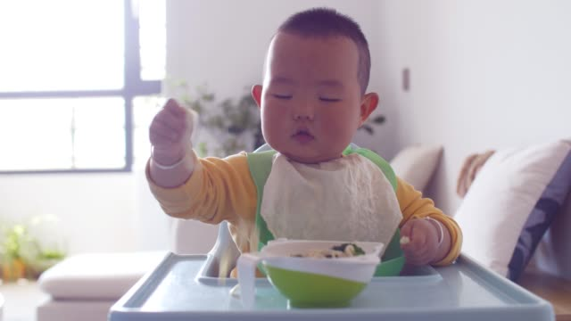 baby boy eating food - messy stock videos & royalty-free footage