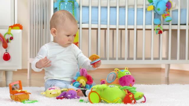 HD: Baby Boy Exploring New Toys