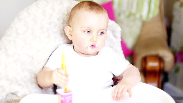 baby boy feeding himself - feeding stock videos & royalty-free footage