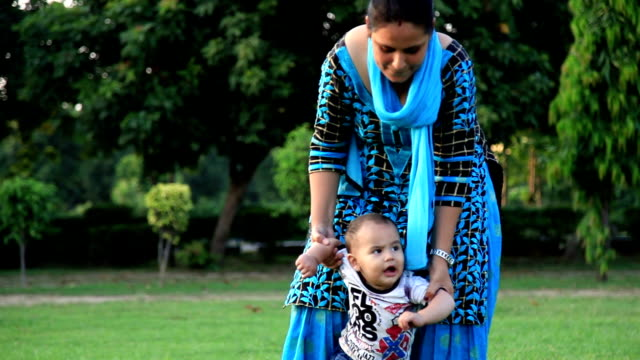 baby boy first steps with her mother - indian mom stock videos & royalty-free footage