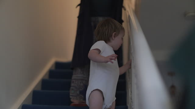 Baby boy Goes Down Stairs with His Mother
