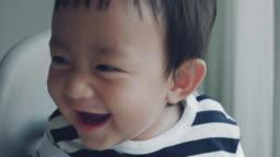 Baby boy (6-11 months) having fun