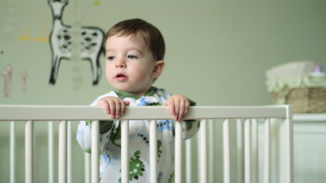 baby boy in crib - cot stock videos & royalty-free footage