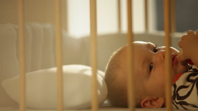baby boy in crib - nursery bedroom stock videos & royalty-free footage