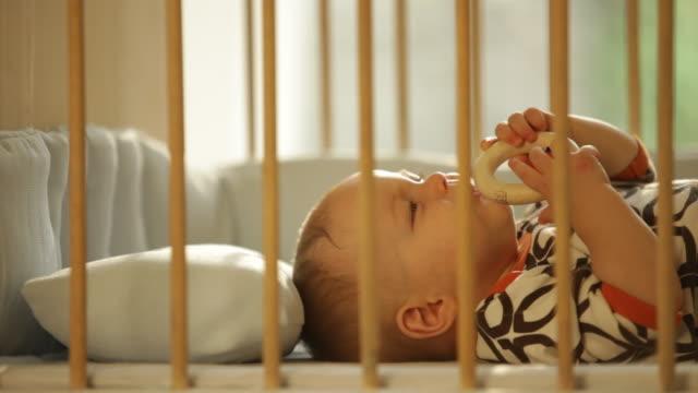 vídeos y material grabado en eventos de stock de baby boy in crib - sólo niños bebés