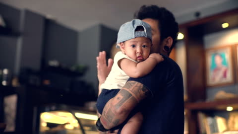 baby boy in father's arms - toddler stock videos & royalty-free footage