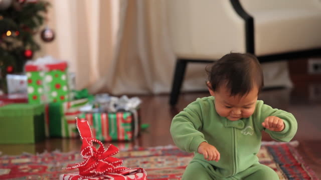 MS TU TD Baby boy (6-11 months) in front of Christmas tree learning to stand up / Richmond, Virginia, USA
