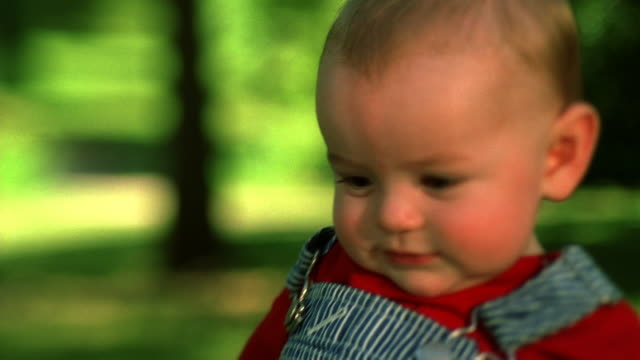 baby boy in striped overalls. - bib overalls stock videos and b-roll footage