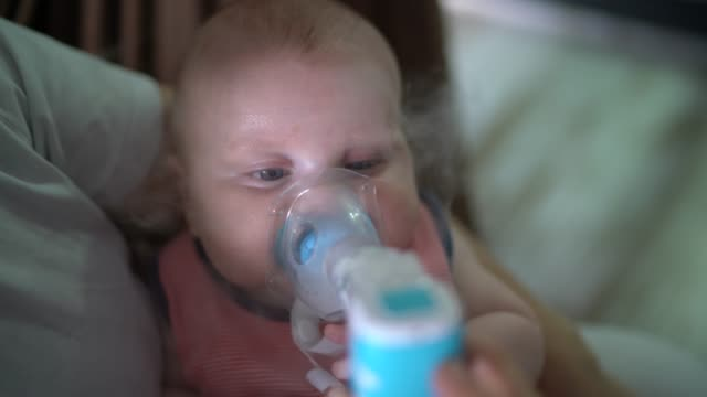 baby boy inhalation therapy by the mask of inhaler - medical supplies stock videos & royalty-free footage