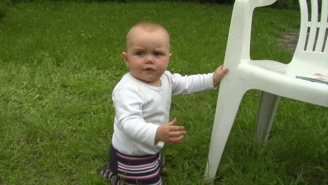 cu baby boy (6-11 months) kneeling against plastic chair / berlin, germany - 6 11 months stock videos & royalty-free footage
