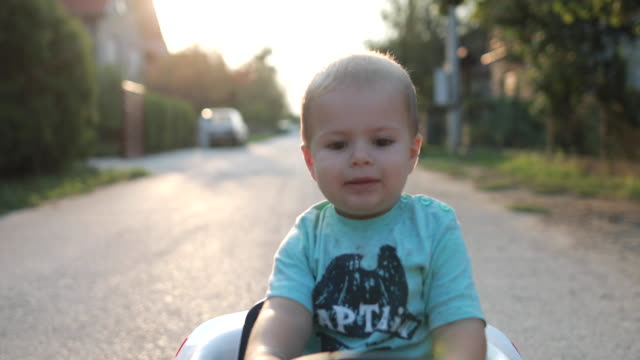 baby boy learning to drive - baby boys stock videos and b-roll footage
