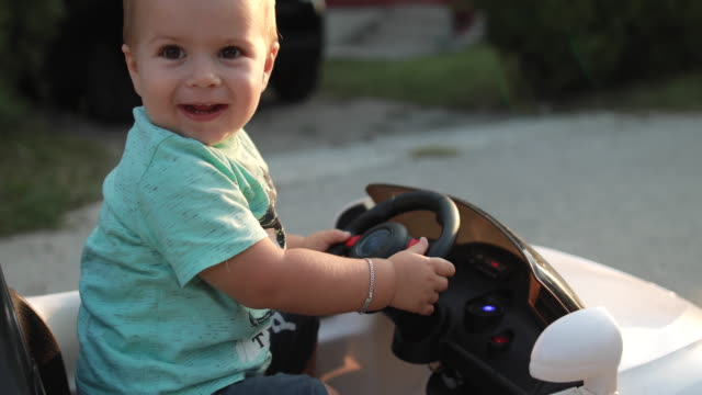 baby boy learning to drive - baby boys stock videos & royalty-free footage