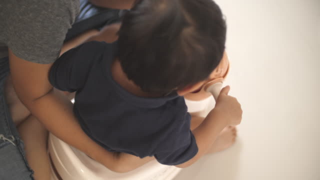 baby boy learning pisses in his potty - defecating stock videos and b-roll footage
