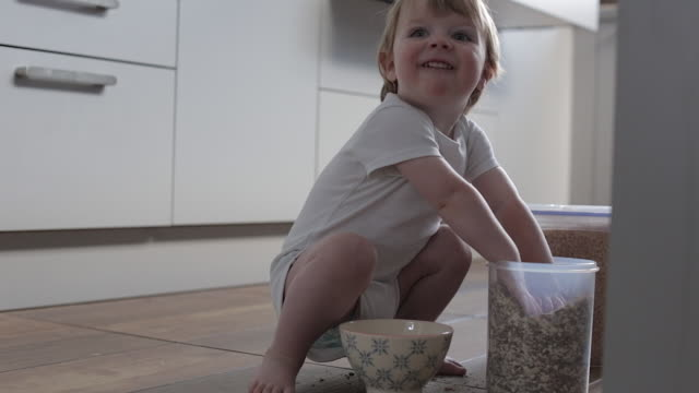 baby boy making a messy breakfast - messy stock videos and b-roll footage
