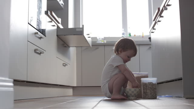 baby boy making breakfast - messy stock videos and b-roll footage