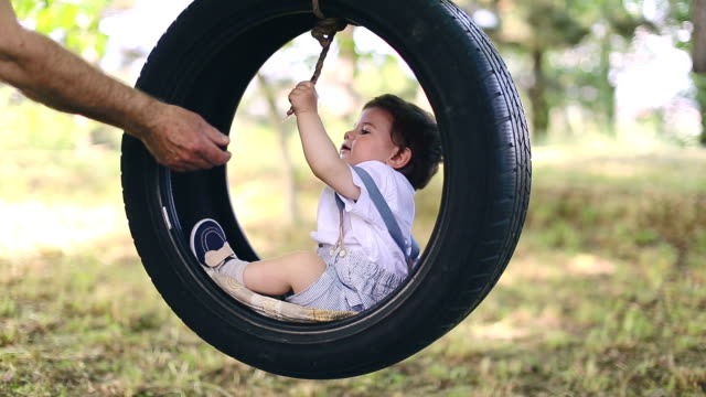 baby boy on tire swing - tyre swing stock videos & royalty-free footage