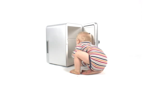 baby boy opening refrigerator - appliance stock videos & royalty-free footage