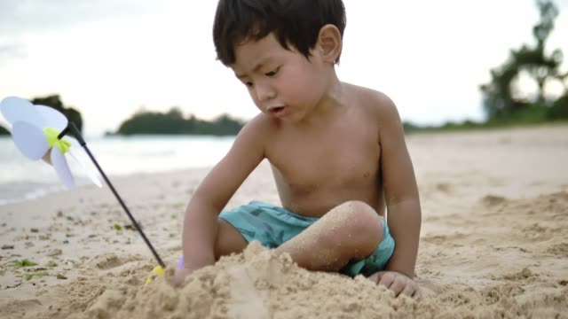 baby boy play sand on the beach - one baby boy only stock videos & royalty-free footage