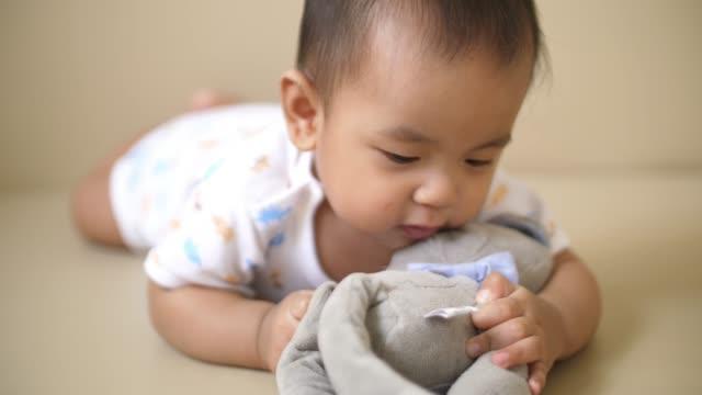 baby boy playing teddy bear - teddy bear stock videos & royalty-free footage