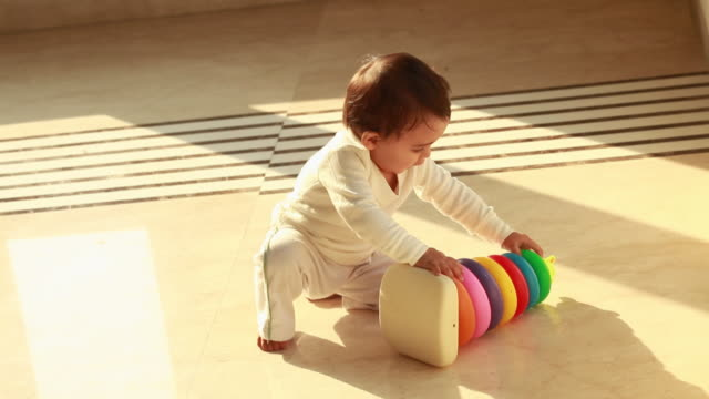 baby boy playing with a plastic toy  - babies only stock videos & royalty-free footage