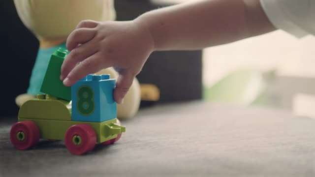 baby boy playing with a toy car. - block shape stock videos & royalty-free footage