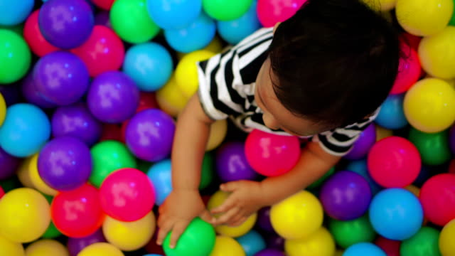 baby boy playing with colorful ball. - 6 11 months stock videos & royalty-free footage