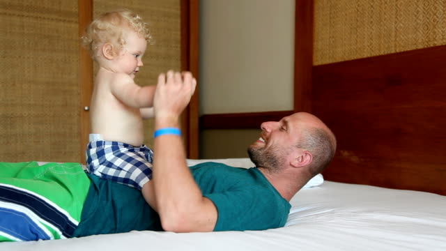 baby boy playing with dad - genderblend stock videos & royalty-free footage