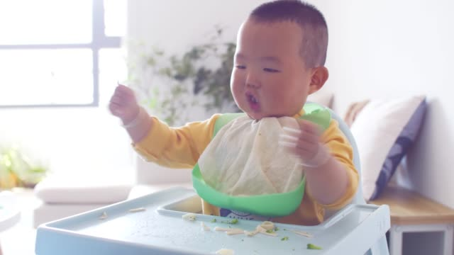 baby boy playing with his food - imperfection stock videos & royalty-free footage