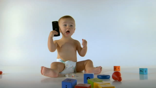 WS, Baby boy (6-11 months) playing with mobile phone