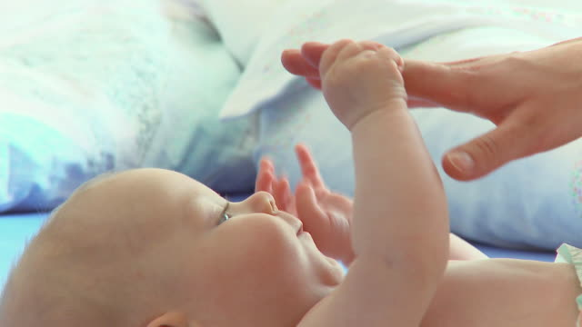 cu td baby boy (2-5 months) playing with mother's hand / vrhnika, slovenia - nappy stock videos & royalty-free footage