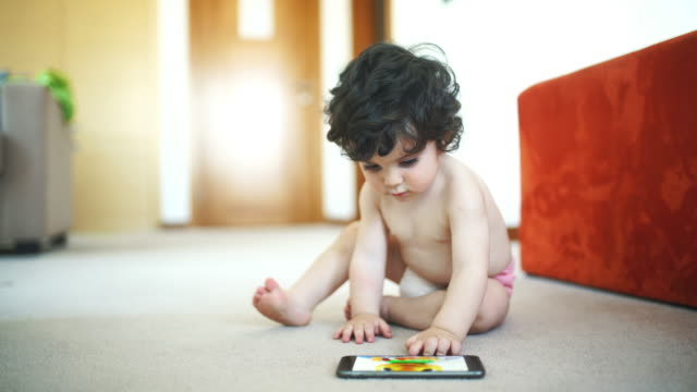 baby boy playing with smartphone. - one baby boy only stock videos & royalty-free footage