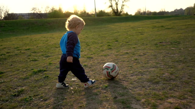 baby boy playing with soccer ball - toddler stock videos & royalty-free footage