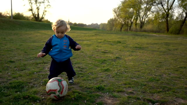 baby boy playing with soccer ball - baby boys stock videos and b-roll footage