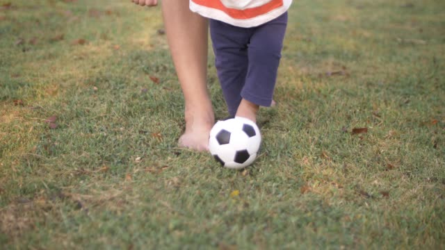 Baby boy playing with soccer ball